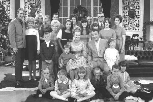 """Western stars Roy Rogers and his wife Dale Evans are shown with their six children, their spouses and 13 grandchildren at a taping of the """"Jonathan Winters"""" television show in this Dec. 1968 file photo. (AP Photo/File)"""