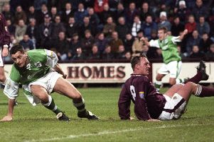 Hibs midfielder Pat McGinlay gets to his feet to celebrate after scoring in the Edinburgh New Year derby in 1998. Pic: SNS
