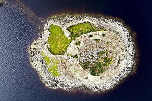 Dun Torcuill: Iron Age broch on loch in North Uist where a case of illegal excavation is being investigated. Picture: Contributed
