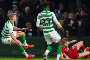 Kristoffer Ajer, left, goes to ground after a tackle by Aberdeen defender Sam Cosgrove. Picture: SNS