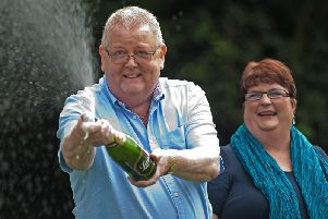 Colin Weir celebrates his lottery win. Picture: Getty Images