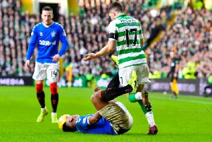 Ryan Christie tussles with Alfredo Morelos during Rangers' 2-1 win at Celtic Park. Picture: Rob Casey / SNS