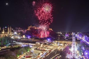 Tens of thousands of revellers flooded into Edinburgh city centre for its Hogmanay celebrations.
