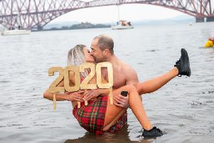 The Loony Dook is staged against the iconic backdrop of the Forth Bridge.