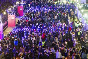 Some of the 75,000 audience who attended Edinburgh's Hogmanay.