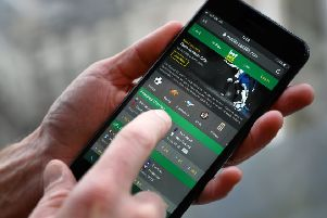 Online gambling is a lucrative business ' the co-founder and major shareholder in Bet365 raked in a �323m pay packet last year. Picture: AFP/Getty
