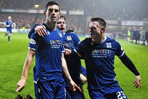 Graham Dorrans celebrates his equaliser in Dundee's derby draw with Dundee United in December. Picture: Rob Casey/SNS