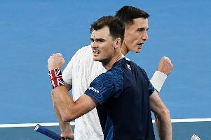 Britain's Jamie Murray, left, and Joe Salisbury celebrate winning a point in their doubles victory over Sander Gille and Joran Vliegen of Belgium. Picture: William West/AFP via Getty Images