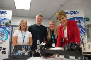 Diodes employees Caitlin Kirk, Ross MacDonald and Aimee Cooke with First Minister Nicola Sturgeon. Picture: Contributed