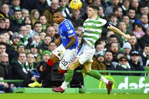 Rangers' Alfredo Morelos, left, and Celtic's Ryan Christie tussle during the game on 29 January.