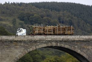 A timber lorry travels over the bridge over the Tay at Dunkeld, Perthshire. tourism. for special reports. forestry. wood.
