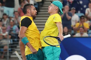 Nick Kyrgios and Alex De Minaur do a chest bump after their quarter-final victory in the ATS Cup. Picture: Getty.