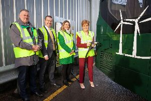 Nicola Sturgeon charging up one of the electric buses today at First Glasgow's Caledonia depot. Picture: SP Energy Networks