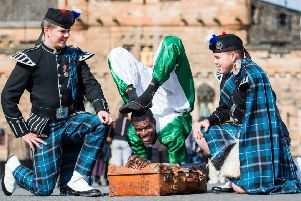 Adam Hill and Cameron O'Neill, of Pipers Trail, with Nigerian contortionist Aminu Haladu' at last year's Royal Edinburgh Military Tattoo (Picture: Ian Georgeson)
