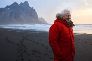 Programme Name: Seven Worlds, One Planet - TX: n/a - Episode: n/a (No. n/a) - Picture Shows: *EARLY RELEASE no embargo* Sir David Attenborough on windy Stokksnes beach in Iceland filming for Seven Worlds, One Planet.''Social Media Use'Unless specified to the contrary below, it is permitted to post the image on social network sites such as Facebook provided they are reduced to 72dpi and no more than 720 x 491 pixels in size and the programme title and full copyright credit. Sir David Attenborough - (C) BBC NHU - Photographer: Alex Board