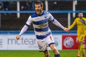 Kyle Jacobs celebrates drawing hosts Morton level at a rain-soaked Cappielow.  Picture: SNS.