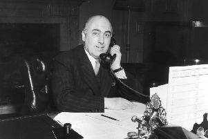 29th October 1951:  Scottish jurist and statesman Sir David Maxwell Fyfe (1900 - 1967), 1st Earl of Kilmuir, home secretary and minister for Welsh affairs, speaking on the telephone.  (Photo by Monty Fresco/Topical Press Agency/Getty Images)