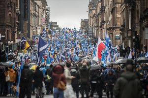 Pro-independence marchers make their way along West George Street in Glasgow on Saturday. Picture: John Devlin