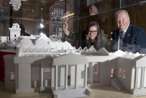 Lisa-Marie Hughes, chair of Renfrewshire Leisure, and Martyn Wade, a member of the Scotland committee at the National Lottery Heritage Fund, look over the plans for the revamped museum.