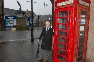 Hawick councillor Davie Paterson at one of the town's phone boxes, opposite Oliver Place.