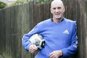 John Martin, now 61 and still living in Prestonpans, helps coach local youth team Musselburgh Windsor and works in Tesco. Picture: Alistair Linford