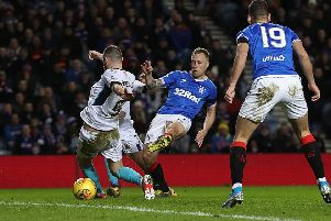 Midfielder Scott Arfield slots home Rangers' first goal against Stranraer shortly before half-time at Ibrox. Picture: Ian MacNicol/Getty