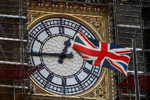 The Union flag flutters near the clockface of Big Ben during ongoing renovations to the Tower. Picture: AFP