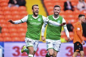 Christian Doidge celebrates after his goal opened the scoring for Hibs at Tannadice. Picture: SNS.