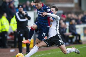 Ross County's Josh Mullin, left, and Daniel Harvie of Ayr tussle near the touchline on Saturday. Picture: SNS