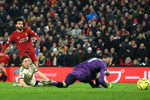 Mo Salah watches his shot slide past David de Gea to seal Liverpool's 2-0 victory at Anfield. Picture: Getty