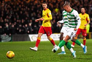 Leigh Griffiths scores to give Celtic the lead against Partick Thistle. Picture: SNS