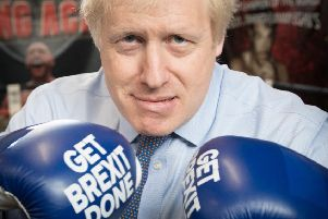 Boris Johnson during a visit to Jimmy Egan's Boxing Academy at Wythenshawe during the general election campaign (Picture: Stefan Rousseau/PA Wire)