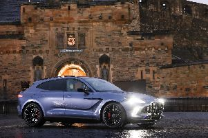 Aston Martin recently launched its latest model, the DBX, pictured at Edinburgh Castle. Picture: Contributed