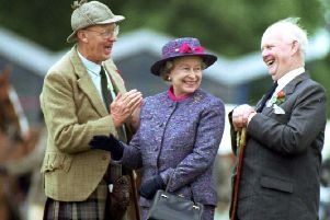 RHS president Jack Sleigh (right) with the Queen and judge Ewan Ormiston at the Royal Highland Show in 1992.