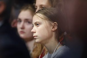 Swedish environmental activist Greta Thunberg listened as U.S. President Donald Trump addresses the World Economic Forum in Davos. Picture: AP Photo/Markus Schreiber