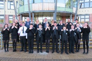 Staff and pupils at Earlston High School celebrating being given the thumbs-up by Education Scotland.