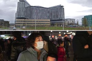 It has been reported that two patients at Glasgow's Queen Elizabeth Hospital (top) have been isolated. The outbreak of coronavirus began in China (bottom).