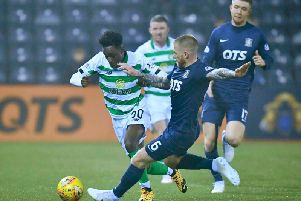 Jeremie Frimpong, left, was injured after a tackle by Kilmarnock's Alan Power. Picture: SNS