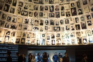 People visit the Hall of Names in Israel's Yad Vashem Holocaust museum  (Picture: Lior Mizrahi/Getty Images)