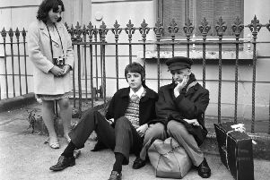 Ivor Cutler, the sixth or seventh Beatle, and Paul McCartney wait for their tour bus in London in 1967 (Picture: Jim Gray/Keystone Features/Getty Images)