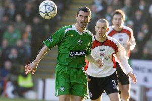 Clyde's Eddie Malone keeps an eye on Celtic debutant Roy Keane during the dramatic 2006 Scottish Cup tie. Picture: Jeff Holmes/SNS