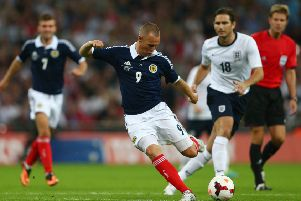 One of Kenny Miller's finest goals as he sweeps the ball home against England at Wembley in his final appearance for Scotland in 2013. Picture: Clive Mason/Getty Images