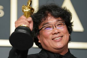 Bong Joon Ho celebrates after his film Parasite won four Oscars - including a historic 'Best Picture' award (Picture: Getty)