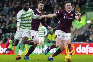 John Souttar, right, says Hearts cannot afford to dwell on their midweek defeat by Celtic as they prepare to face fellow Premiership strugglers Hamilton and St Mirren in the next seven days. Picture: Alan Harvey/SNS