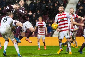 Craig Halkett rescued a point for Hearts at the death