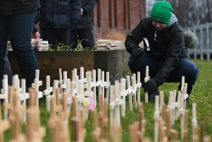 Steven Currie leaves a cross for his brother, Peter, at Springburn Parish Church. Picture: John Devlin