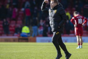 Manager Neil Lennon is jubilant as the final whistle sounds on Celtic's 2-1 victory at Pittodrie.