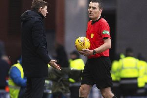 Steven Gerrard confronts referee Euan Anderson at full-time at Ibrox yesterday. Picture: SNS