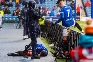 Andy Halliday lays injured after falling over the advertising boards at Ibrox. Picture: SNS