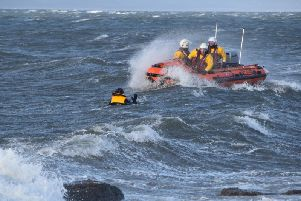 The RNLI close in on the stranded windsurfer